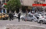 An image from state-run Syrian TV on April 30, 2013, shows the scene following a blast in Damascus