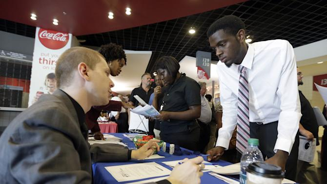 Applications for US jobless aid fall to nearly 15-year low