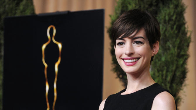 "Anne Hathaway, nominated for best actress in a supporting role for ""Les Miserables,"" arrives at the 85th Academy Awards Nominees Luncheon at the Beverly Hilton Hotel on Monday, Feb. 4, 2013, in Beverly Hills, Calif. (Photo by Chris Pizzello/Invision/AP)"