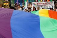 Supporters of the lesbian, gay, bisexual and transgender community (LGBT) take part in the Hong Kong gay pride parade in 2011. Most of Hong Kong's sexual minority employees face discrimination in the workplace, threatening the city's competitiveness as a financial hub, according to a study released Thursday
