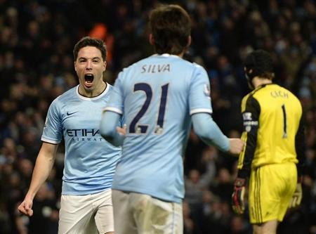Manchester City's Samir Nasri (L) celebrates after scoring a goal against Chelsea during their English FA Cup fifth round soccer match at the Etihad Stadium in Manchester, northern England February 15, 2014. REUTERS/Nigel Roddis