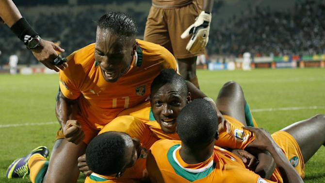 Ivory Coast's Didier Drogba, left, celebrates with his teammates after scoring a goal in a World Cup 2014 qualifying match between Ivory Coast and Senegal at Mohammed V stadium in Casablanca, Morocco, Saturday Nov. 16, 2013. Ivory Coast qualified for the World Cup tournament by beating Senegal 4-2 on aggregate in a playoff for next year's finals in Brazil after a 1-1 draw