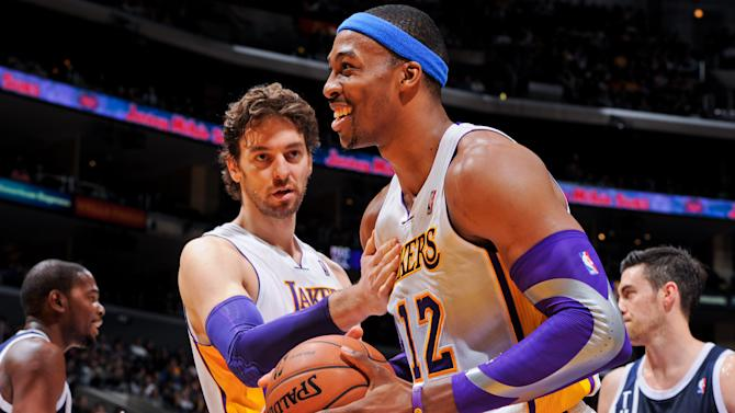 FILE - Pau Gasol #16 and Dwight Howard #12 of the Los Angeles Lakers celebrate during a game against the Oklahoma City Thunder at Staples Center on January 27, 2013 in Los Angeles, California. NOTE TO USER: User expressly acknowledges and agrees that, by downloading and/or using this photograph, user is consenting to the terms and conditions of the Getty Images License Agreement. Mandatory Copyright Notice: Copyright 2013 NBAE (Photo by Andrew D. Bernstein/NBAE via Getty Images)