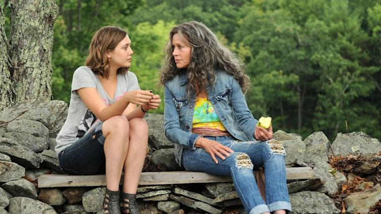 "This image released by IFC Films shows Elizabeth Olsen, left, and Jane Fonda in a scene from ""Peace Love and Misunderstanding."" (AP Photo/IFC Films)"