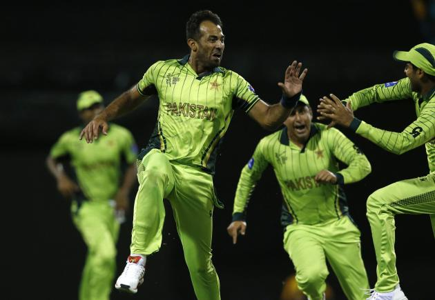 Pakistan's Wahab Riaz celebrates with team mates after dismissing Zimbabwe's Tawanda Mupariwa for a duck during their Cricket World Cup match at the Gabba in Brisbane