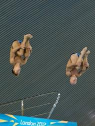 Britain's Tom Daley (L) and Peter Waterfield during a practice session ahead of the London 2012 Olympic Games. Daley, who relinquished his world title to Qiu Bo last year, clings to the hope the Chinese superstar will crack under pressure in Sunday's competition
