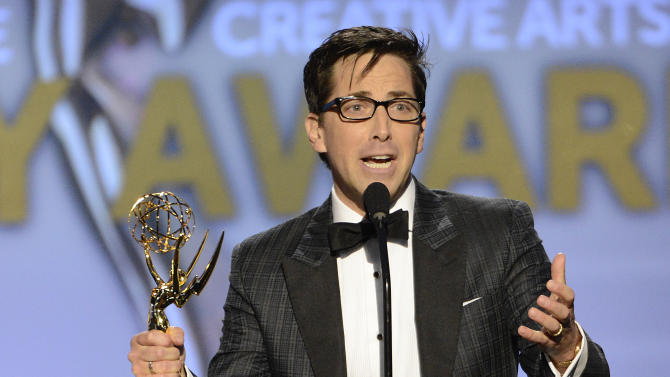 Dan Bucatinsky accepts the award for Outstanding Guest Actor in a Drama Series for Scandal onstage at the 2013 Primetime Creative Arts Emmy Awards, on Sunday, September 15, 2013 at Nokia Theatre L.A. Live, in Los Angeles, Calif. (Photo by Phil McCarten/Invision for Academy of Television Arts & Sciences/AP Images)