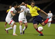 North Korea's Kim Nam Hui (L) vies with Colombia's Orianica Velasquez (R) during the Women's Olympic football match North Korea vs Colombia at Hampden Park, in Glasgow, Scotland. North Korea's women's football team refused to take the field for more than an hour Wednesday in protest at an embarrassing mix-up of their national flag on day one of the London Olympics