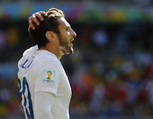 England's Lallana reacts after missing a chance to score against Costa Rica during their 2014 World Cup Group D soccer match at the Mineirao stadium in Belo Horizonte