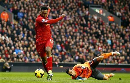 Liverpool's Sturridge scores past Swansea's Vorm during their English Premier League soccer match in Liverpool