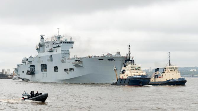 HMS Ocean Sails Up The River Thames For An Olympic Exercise