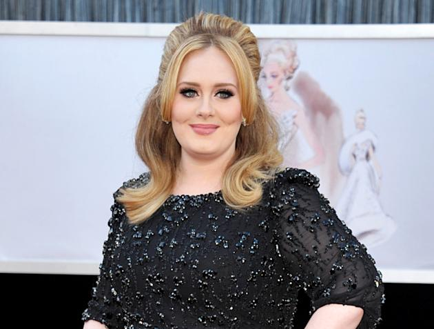 "FILE - In this Feb. 24, 2013 file photo, singer Adele arrives at the Oscars in Los Angeles. Adele's new album ""25"" has sold more than 2.3 million copies in the United States during its f"
