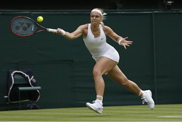 The Latest: Nadal a set away from losing at Wimbledon