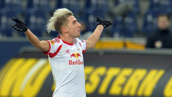 Salzburg's Kevin Kampl celebrates after scoring  during the Europa League group C soccer match  between Red  Bull Salzburg and Esbjerg fB  in Salzburg , Austria, Thursday, Dec  12, 2013