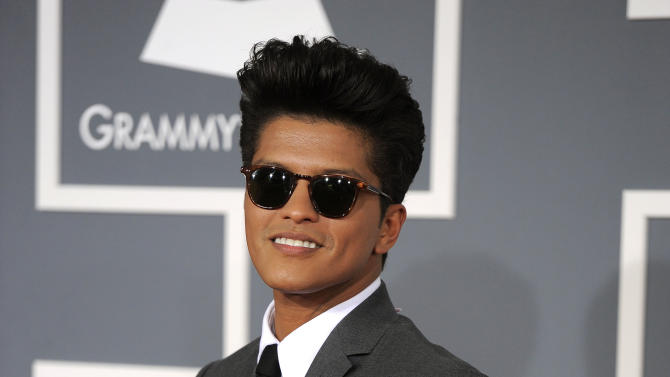 FILE - In this Feb. 12, 2012 file photo, Bruno Mars arrives at the 54th annual Grammy Awards in Los Angeles. The mother of Grammy-winning pop star Bruno Mars has died. Bernadette Hernandez died Saturday, June 1, 2013 of a brain aneurysm, according to a publicist for Mars' label, Atlantic Records, who spoke to The Associated Press on condition of anonymity because the person was not authorized to speak on the record.(AP Photo/Chris Pizzello, File)
