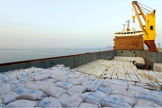 A handout picture released by the World Food Programme shows a UN aid ship docked in Yemen's devastated port city of Aden on July 21, 2015