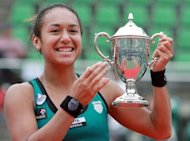 British player Heather Watson poses with the trophy after winning the Japan Women's Open tennis tournament in Osaka on October 14, 2012. Watson became the first British woman in 24 years to win a WTA singles title after edging past Chang Kai-chen of Taiwan 7-5, 5-7, 7-6 (7/4) on Sunday