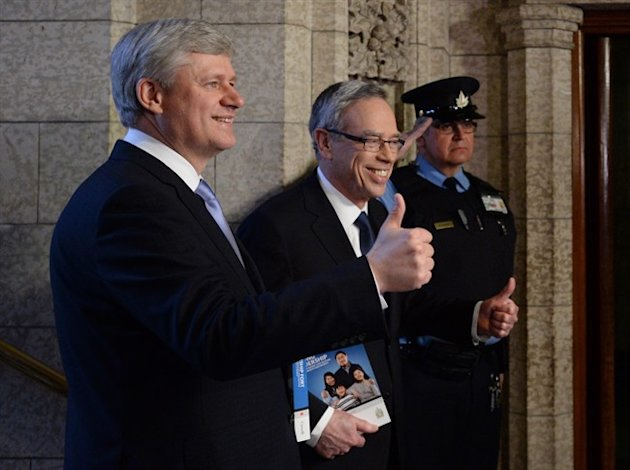 Prime Minister Stephen Harper accompanies Finance Minister Joe Oliver as he makes his way to deliver the federal budget in the House of Commons on Parliament Hill in Ottawa on Tuesday, April 21, 2015. THE CANADIAN PRESS/Sean Kilpatrick