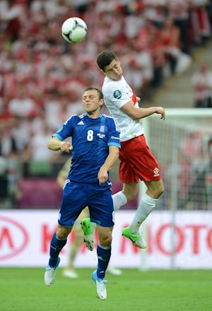 Avraam Papadopoulos (left) suffered knee ligament damage and will miss the rest of Euro 2012