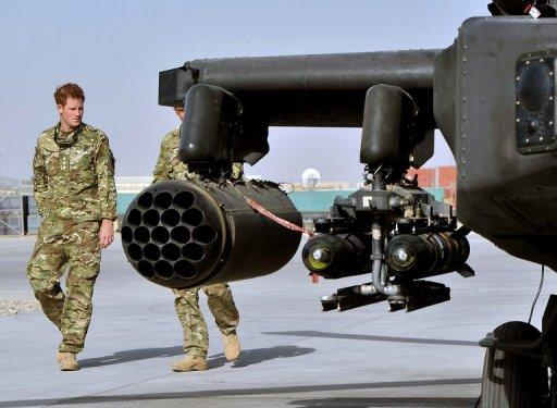 Britain's Prince Harry (L) is shown an Apache helicopter upon his arrival at Camp Bastion in Afghanistan, on September 7. Harry was moved under guard to a secure location during a Taliban attack on the camp last Friday, the base where he is deployed in Afghanistan, according to Britain's defence minister.