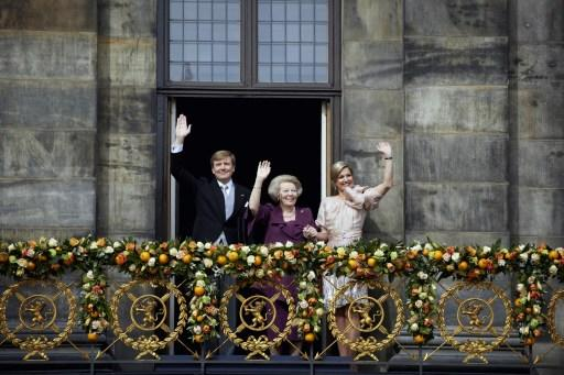 (From L) The new Dutch King Willem-Alexander, Princess Beatrix and Queen Maxima wave on the balcony after the abdication ceremony of the King's mother at the Royal Palace in Amsterdam, The Netherlands