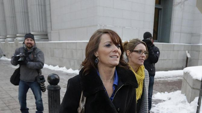 Polygamists Valerie Darger, left, and Vicki Darger, walk from the Frank E. Moss United States Courthouse after a hearing on whether Utah can prohibit plural marriage, Thursday, Jan. 17, 2013, in Salt Lake City. (AP Photo/Rick Bowmer)
