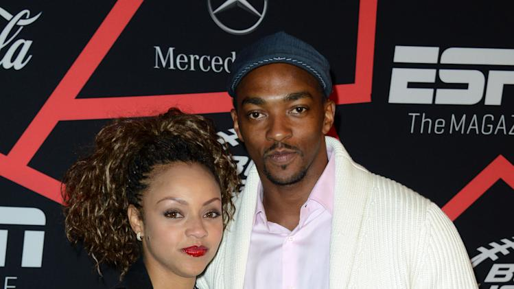 "Actor Anthony Mackie, right, and Sheletta Chapital arrive at ESPN The Magazine's ""Next"" Event on Friday, Feb. 1, 2013 in New Orleans. (Photo by Jordan Strauss/Invision/AP)"