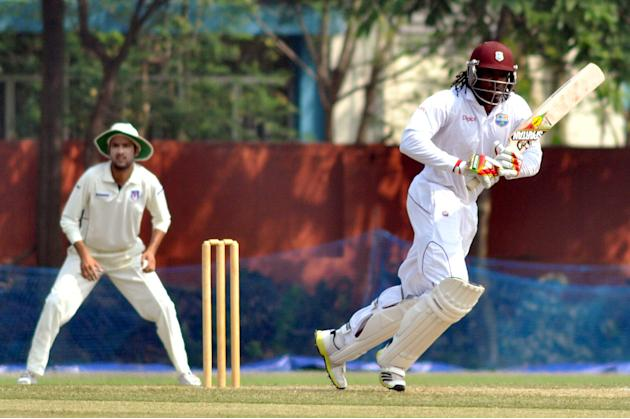West Indies player Chris Gayle fetches a run during a practice match between Uttar Pradesh Cricket Association XI and West Indies at the Jadavpur University Ground in Kolkata on Oct.31, 2013. (Photo: