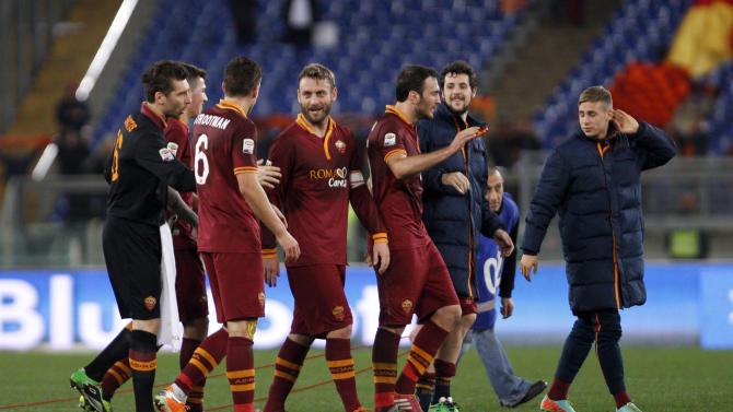 AS Roma players, including Kevin Strootman, third from left, and Daniele De Rossi, center, celebrate at the end of a Serie A soccer match between AS Roma and Sampdoria, at Rome's Olympic stadium, Sunday, Feb. 16, 2014. AS Roma won 3-0
