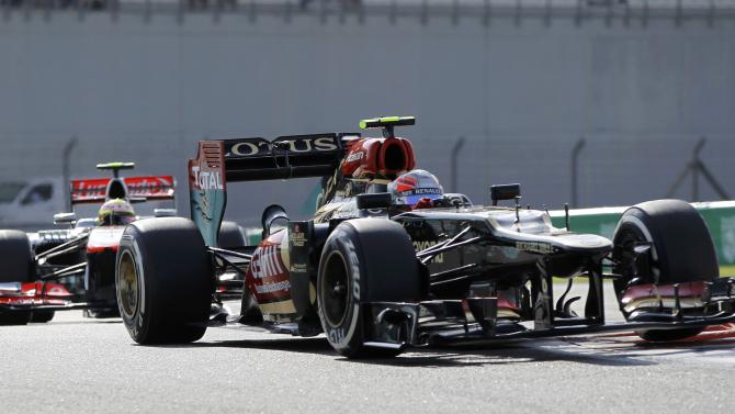 Lotus F1 Formula One driver Grosjean drives ahead of McLaren Formula One driver Perez during the third practice session of the Abu Dhabi F1 Grand Prix at the Yas Marina circuit on Yas Island