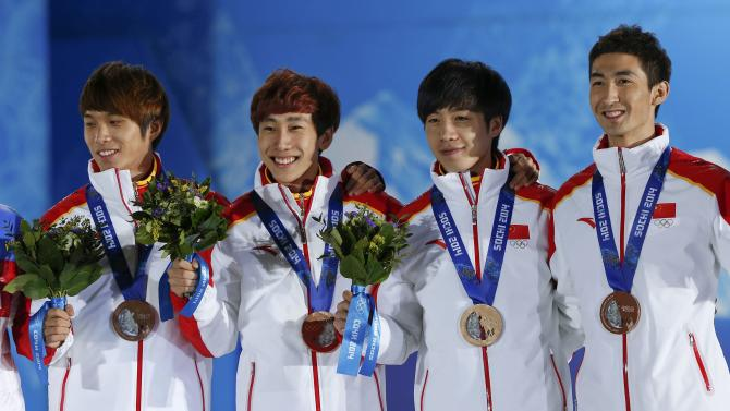 Bronze medallists China's Chen, Han, Shi and Wu pose with medals during the victory ceremony for the men's 5,000 metres relay short track speed skating event at the 2014 Sochi Winter Olympics in Sochi