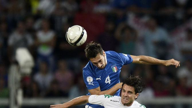 Italy's Astori jumps for the ball with Bulgaria's Nedelev during their World Cup qualifying soccer match at the Renzo Barbera Stadium in Palermo