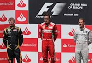 L to R: Lotus F1 Team's Finnish driver Kimi Raikkonen, Ferrari's Spanish driver Fernando Alonso and Mercedes' German driver Michael Schumacher celebrate on the podium at the Valencia Street Circuit in Valencia after the European Formula One Grand Prix