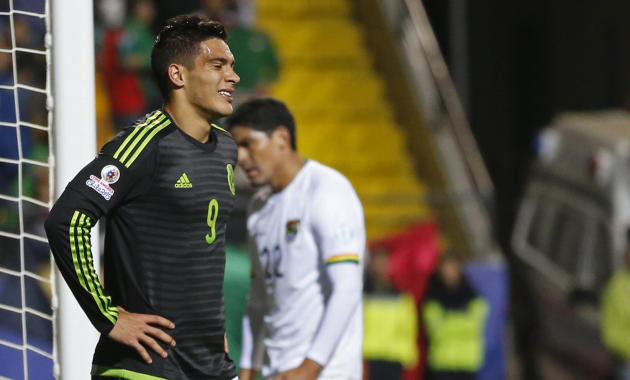 Mexico's Raul Jimenez reacts after missing a chance to score during a Copa America Group A soccer match against Bolivia at the Sausalito Stadium in Vina del Mar, Chile, Friday, June 12, 2015. (AP Photo/Silvia Izquierdo)