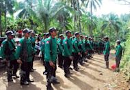 File illustration photo shows New People's Army rebels at an unspecified location in the southern Philippine island of Mindanao in 2009. Two communist rebels and a soldier have been killed in separate clashes in the Philippines, military officials said Sunday