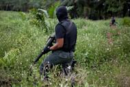 Malaysian police commandos stand guard near the village of Sahabat on the Malaysian island of Borneo on February 19, 2013. Shots were fired Friday in a village at the centre of a stand-off between Philippine gunmen and security forces in the Malaysian state of Sabah, the foreign department said
