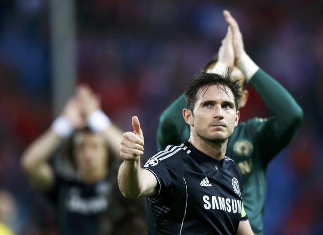 Chelsea's Frank Lampard acknowledges the crowd at the end of his team's Champion's League semi-final first leg soccer match against Atletico Madrid in Madrid