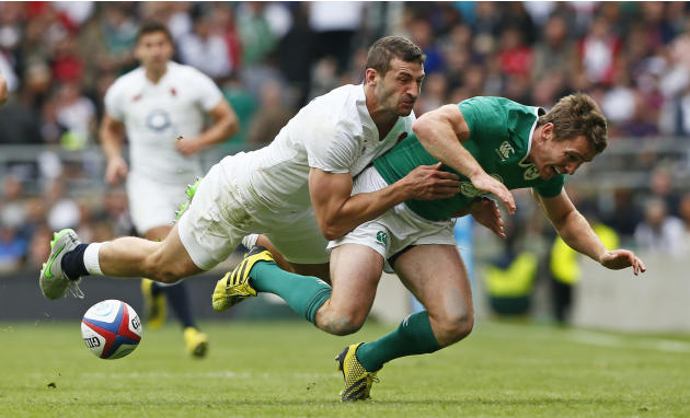 Eoin Reddan of Ireland gets tackled by Jonny May of England