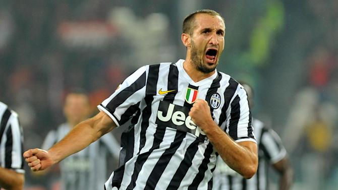 Juventus defender Giorgio Chiellini celebrates after scoring during a Serie A soccer match between Juventus and AC Milan at the Juventus stadium, in Turin, Italy, Sunday, Oct. 6, 2013