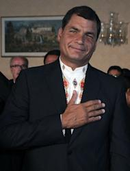 Ecuadorean President Rafael Correa celebrates re-election at the Carondelet presidential palace in Quito on February 17, 2013. Correa declared victory in the first-round of Ecuador's presidential vote Sunday as he celebrated with thousands of supporters in the capital of the South American country