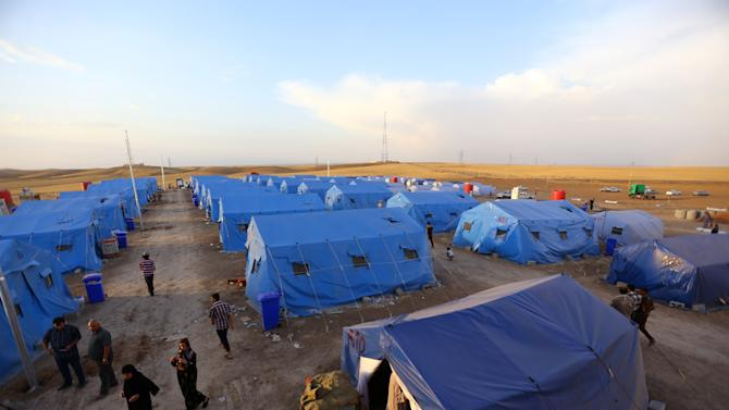 Iraqi refugees from Mosul at Khazir refugee camp outside Irbil, 217 miles (350 kilometers) north of Baghdad, Iraq, Friday, June 13, 2014. The Islamic State of Iraq and the Levant, the al-Qaida breakaway group, on Monday and Tuesday took over much of Mosul in Iraq and then swept into the city of Tikrit further south. An estimated half a million residents fled Mosul, the economically important city. (AP Photo)