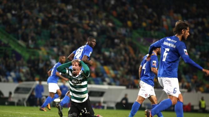 Sporting's Adrien Silva reacts after a missed scoring opportunity against Belenenses during their Portuguese Premier League soccer match in Lisbon