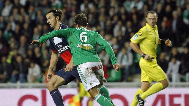 Paris Saint Germain's Zlatan Ibrahimovic, left, controls the ball past Saint-Etienne's Jeremy Clement during their French League One soccer match in Saint-Etienne, central France, Sunday, Oct. 27, 2013