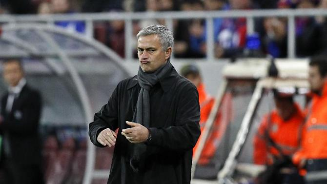 Chelsea manager Jose Mourinho reacts,   during the soccer Champions League group E match between Steaua Bucharest and Chelsea in Bucharest, Romania, Tuesday, Oct. 1, 2013