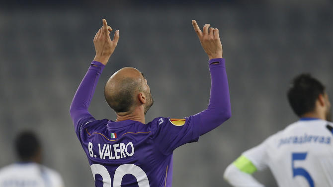 Fiorentina's Borja Valero celebrates scoring in the final moments of an Europa League, group E match, between Fiorentina and Pandurii, at the Cluj Arena stadium in Cluj, Romania, Thursday, Nov. 7,  2013