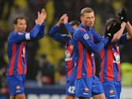 Players of CSKA Moscow celebrate after scoring against Real Madrid during their round of 16, first leg UEFA Champions League match in Moscow. The game ended 1-1