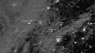 A lightning flash from a line of severe thunderstorms sweeping across the eastern United States was spotted from space by the Suomi NPP satellite on the night of Jan. 29, 2013.