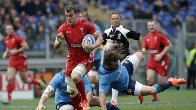 Wales' Sam Warburton runs with the ball on his way to score a try during the Six Nations international rugby union match between Italy and Wales at Rome's  Olympic stadium, Saturday, March 21, 2015. Wales unleashed a stunning seven-try second half to crush Italy 61-20 at Stadio Olimpico and made Ireland and England chase them for the title on Saturday. (AP Photo/Alessandra Tarantino)