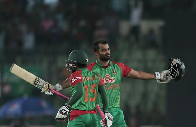 Bangladesh's Tamim Iqbal, right, acknowledges the crowd after scoring hundred during the second one-day international cricket match against Pakistan in Dhaka, Bangladesh, Sunday, April 19, 2015. (AP P