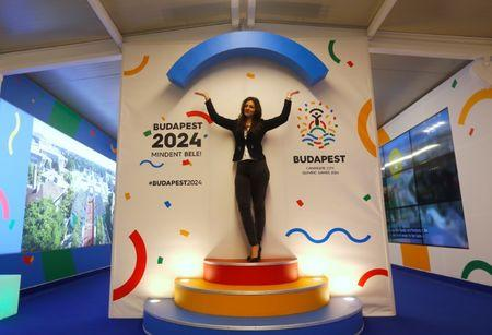 A hostess poses with Hungary's Olympic logo at a promotional spot as the Hungarian capital bids for the 2024 Olympic Games, in central Budapest